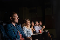 Group of people in multiplex movie theater Stock Photos