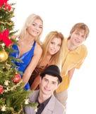 Group people near christmas tree. Stock Photos