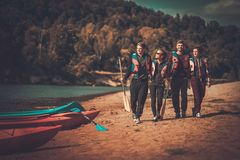 Group of people near kayaks Royalty Free Stock Photos