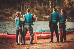 Group of people near kayaks Stock Image