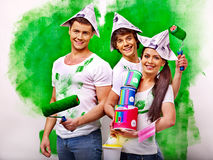 Group people paint wall at home. Stock Photos