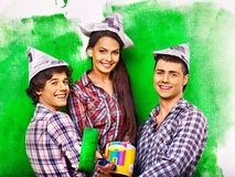 Group people paint wall at home. Stock Photography