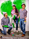 Group people paint wall at home. Happy group people paint wall on stairs at home Stock Photos