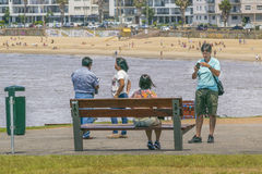 Group of People at Park in Front of Beach stock photos