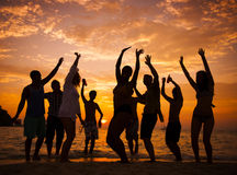 Group of people party on the beach Stock Photos