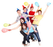 Group of people in party hat and baloon. Royalty Free Stock Photos
