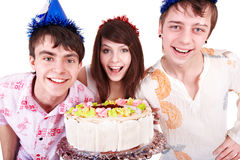 Group people in party hat with   cake. Royalty Free Stock Images