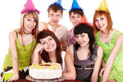 Group people in party hat with   cake. Royalty Free Stock Photos
