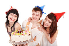 Group of people in party hat with cake. Royalty Free Stock Photo
