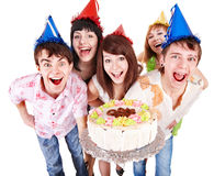 Group of people in party hat with cake. Royalty Free Stock Image