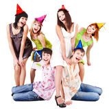 Group of people in party hat celebrate birthday.