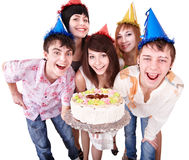 Group people in party hat eat cake. Isolated royalty free stock image