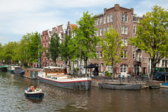 Group of People Passing the Amsterdam Canals on a Boat Royalty Free Stock Photo