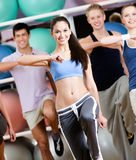 Group of people with perfect figures exercise Stock Photography