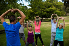 Group of people performing stretching exercise Royalty Free Stock Photography
