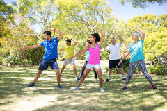 Group of people performing stretching exercise in the park Royalty Free Stock Photos
