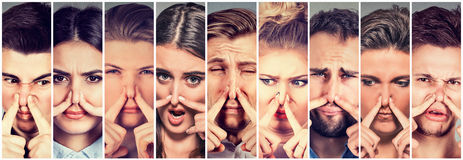 Group of people pinching nose with fingers something stinks bad smell stock photos