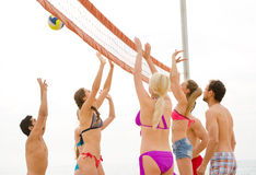 Group of people playing beachvolley Stock Images