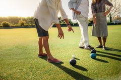 Group of people playing boules in a lawn royalty free stock photos