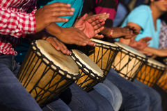 Group of people playing drums - a therapy session. A therapy session going on in an organisation for employees Stock Photo