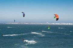 Group of people extreme action by jumping above the sea water with kitesurfing board in green color at Brighton le sands beach. A group of people playing Royalty Free Stock Photos