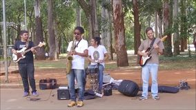 Group of people playing instruments. Sao Paulo, Brazil April 2, 2017: An unidentified group of people playing instruments and enjoying the weekend in a mall of stock footage