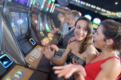 Group people playing slot and various machines Royalty Free Stock Photo