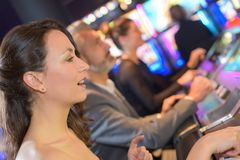 Group people playing slot and various machines. Group of people playing slot and various machines Stock Image