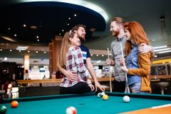 Group of people playing snooker Royalty Free Stock Images