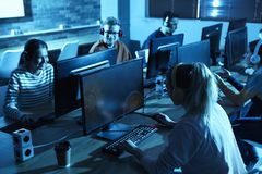 Group of people playing video games stock images