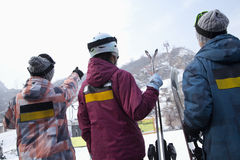 Group of People Pointing at Hill in Ski Resort Stock Image
