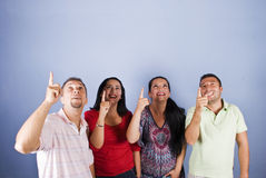 Group of people pointing up to copyspace Royalty Free Stock Photo