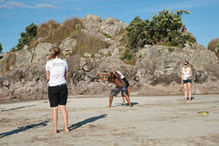 Group of people practice Capoeira on beach. Royalty Free Stock Images