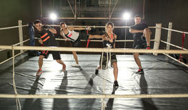 Group of people practicing kick boxing Royalty Free Stock Images