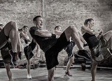 Group of people practicing kick royalty free stock photography