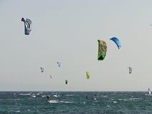 Group of people practicing kitesurf. A group of people practicing or competing in kiteboarding and kitesurf Royalty Free Stock Image