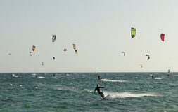 Group of people practicing kitesurf. A group of people practicing or competing in kiteboarding and kitesurf Stock Photo
