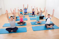 Group of people practicing yoga meditating Stock Photo