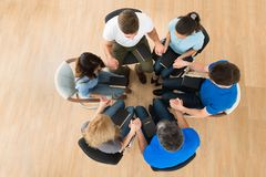 Group Of People Praying Together. High Angle View Of People Holding Each Others Hand Praying Together Stock Images