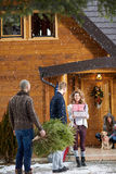 Group people preparing mountain house for Christmas eve Royalty Free Stock Image