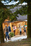 Group people preparing mountain house for New Year eve Royalty Free Stock Image