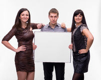 Group of people presenting blank banner Stock Image