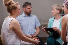 Group of people during psychotherapy Stock Photos