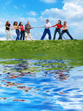 Group of people pulling the rope. Group of happy people pulling the rope with reflection Royalty Free Stock Images
