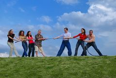 Group of people pulling the rope. Group of happy people pulling the rope Stock Photos