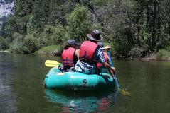 Group of People Rafting Down the River stock image