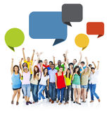 Group of People Raising Hands with Speech Bubbles. Large Group of Cheerful People Raising Hands with Speech Bubbles Stock Photo