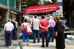 Group of people reading the newspapers in Athens Greece Royalty Free Stock Photos
