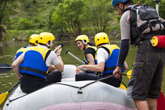 Group of people ready for rafting royalty free stock image