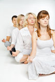 Group of people relaxing and doing yoga in white Stock Image